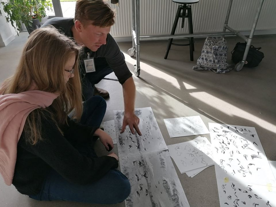 <p>Chris leading a workshop in Højer, where local children learned about drawing barnacle geese in charcoal</p>