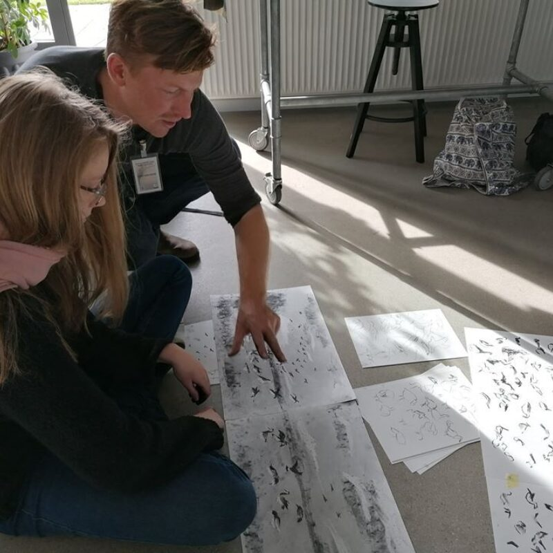 Chris leading a workshop in Højer, where local children learned about drawing barnacle geese in charcoal  © Ulrik Pedersen