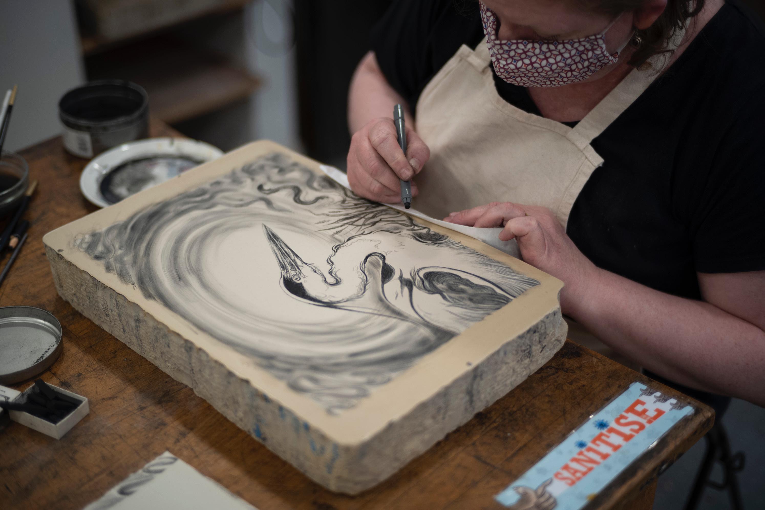 Georgina Coburn drawing on a lithographic printing stone