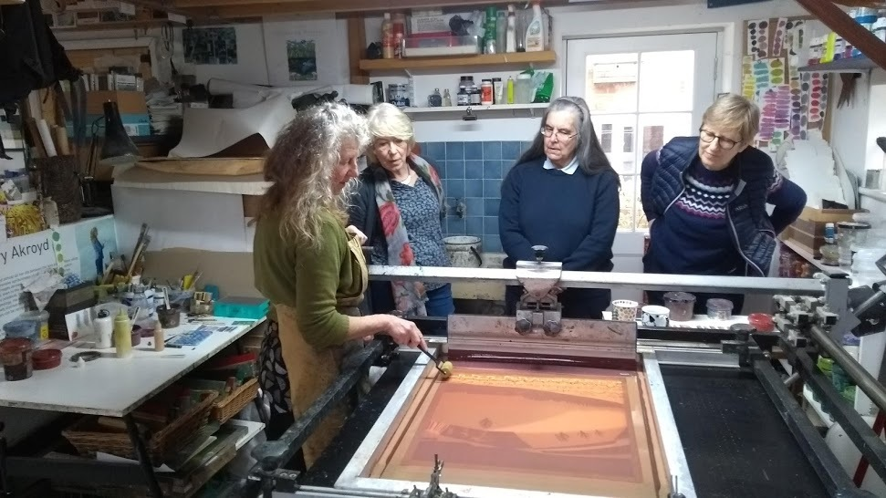 Carry demonstrating screen printing in her home studio  © Tim Baldwin