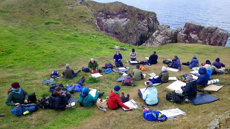Group warm-up exercises at St Abb's Head to start the day